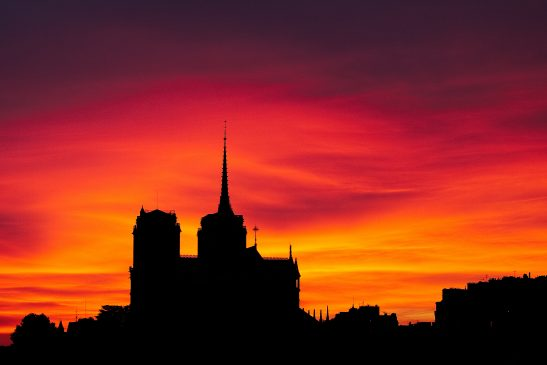 Silhouette of Notre Dame de Paris with a fiery background